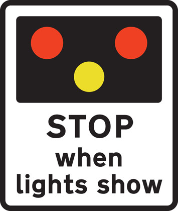 Light signals ahead at level crossing, airfield or bridge