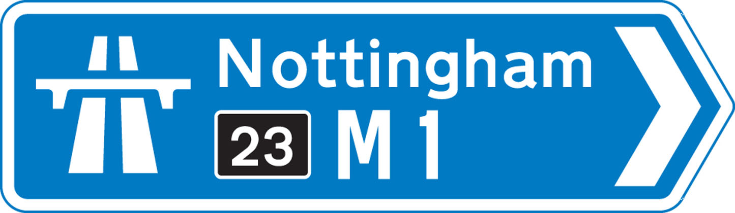 At a junction leading directly into a motorway (junction number may be shown on a black background)