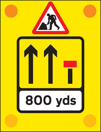 Signs used on the back of slow-moving or stationary vehicles warning of a lane closed ahead by a works vehicle. There are no cones on the road.