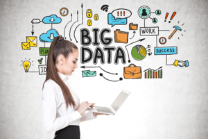 Woman with laptop and Big Data images behind