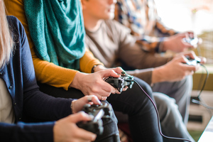 Group of people playing video games.