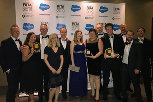 A group photo of the HM Land Registry team celebrating their award wins.