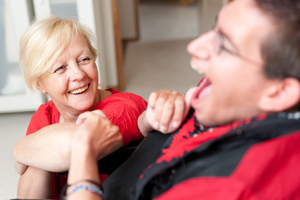 Carer talking to a man with learning disability