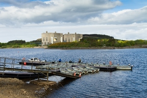 A view of Trawsfynydd nuclear power station (in North Wales) across a piece of water.