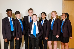 Year 8 children in school uniform