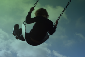Image of a child on a swing