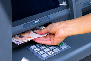 Cash inserted into an ATM machine