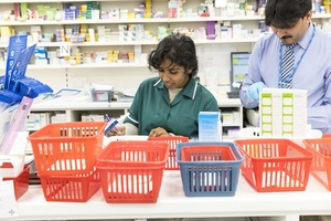 2 pharmacists working at a counter