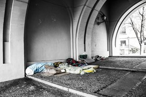 Sleeping bags underneath a bridge