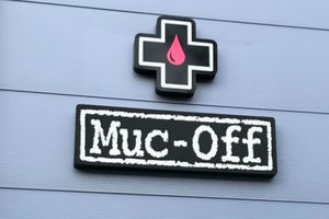 Muc-Off stencil-themed logo outside company's headquarters in Poole