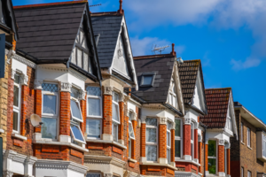 A row of red brick terraced houses in London.