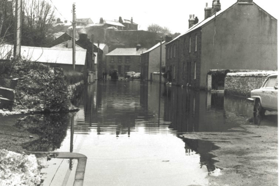 Photograph showing floodwater in St Johns Road, Helston, 15 February 1979
