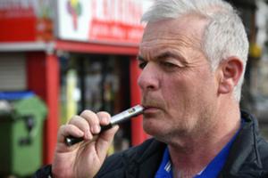 Man inhaling an e-cigarette