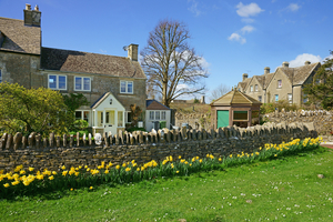 Cotswold stone cottage in spring, Amberley, Stroud, Gloucestershire, UK