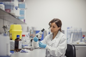 Woman doing work in infectious disease lab