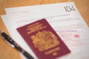 ID4 form with a passport, driving licence and pen.