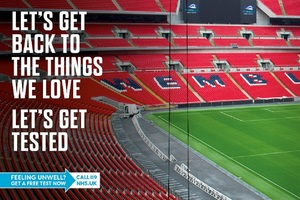 Wembley Stadium seating with the text: Let's get back to the things we love. Let's get tested.