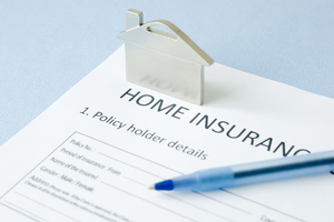 blank home insurance contract with a pen