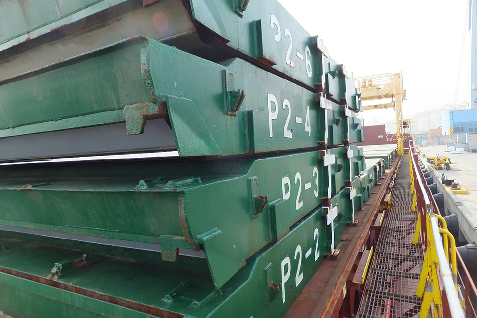 Karina C starboard walkway showing stack of hatch covers