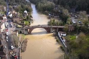 An aerial image of Ironbridge, crossing the River Severn, with the town of the same name either side.